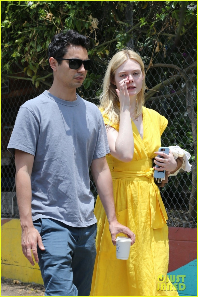 elle fanning holds hands max minghella shopping 304310291