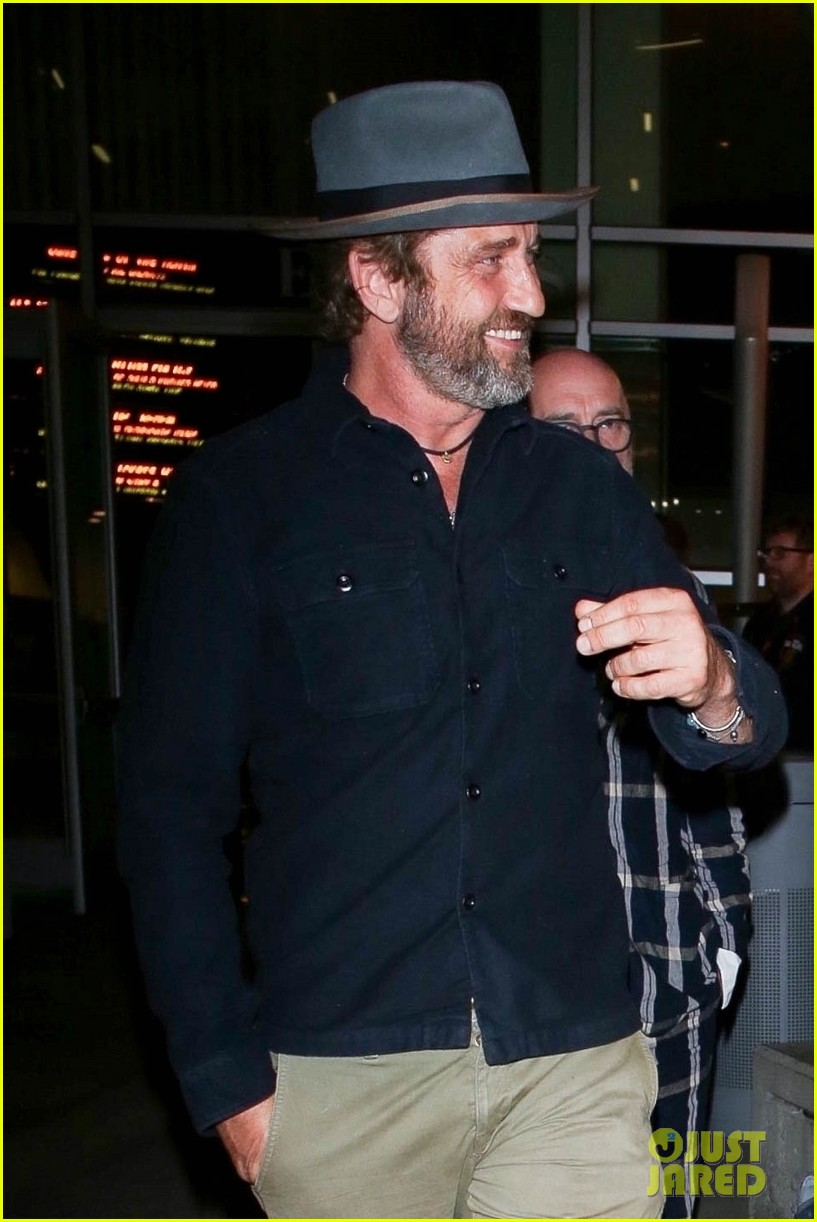 gerard butler is all smiles after enjoying a movie with a