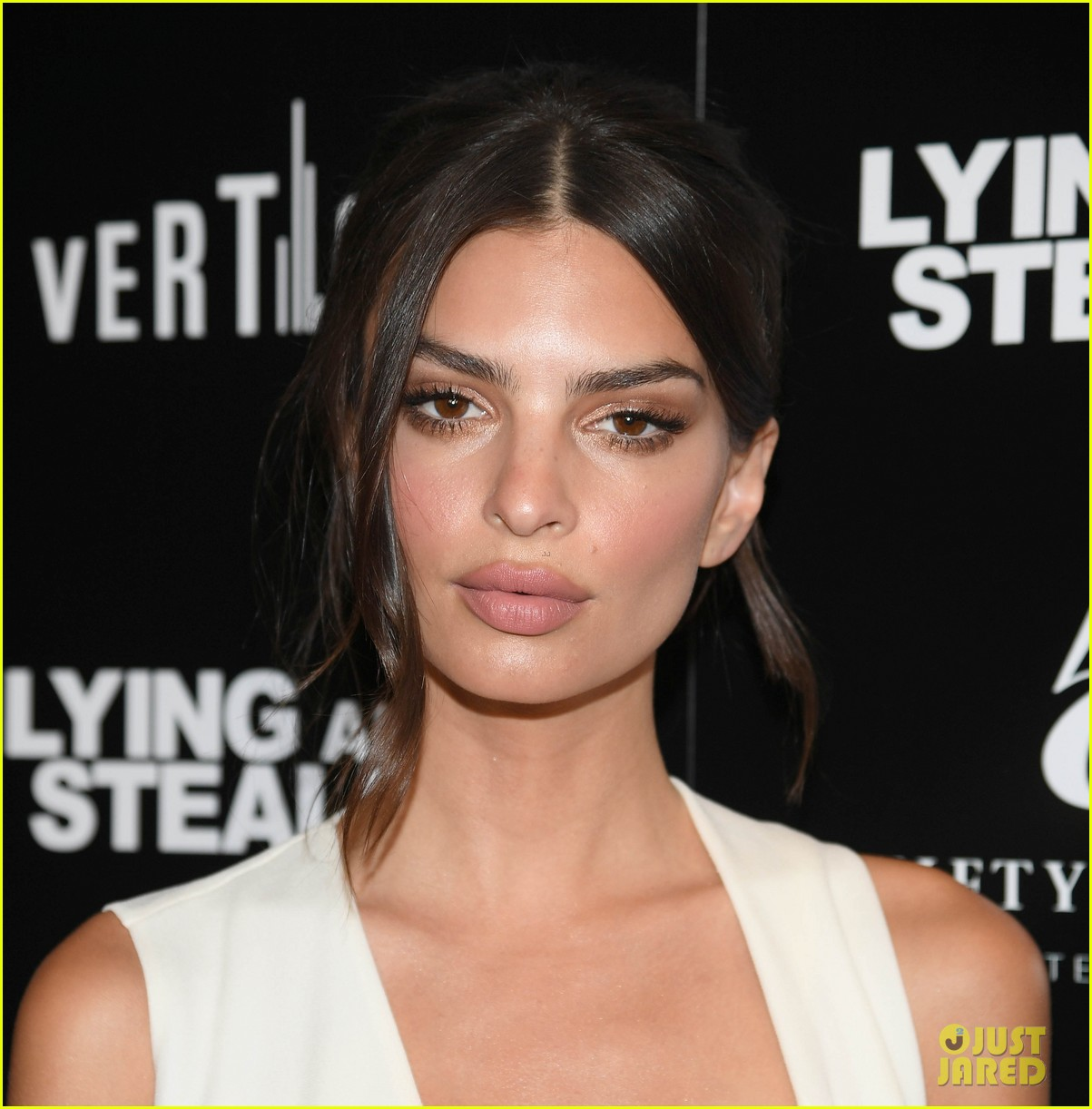 emily ratajkowski wows in white dress at lying and stealing screening in nyc 014311335