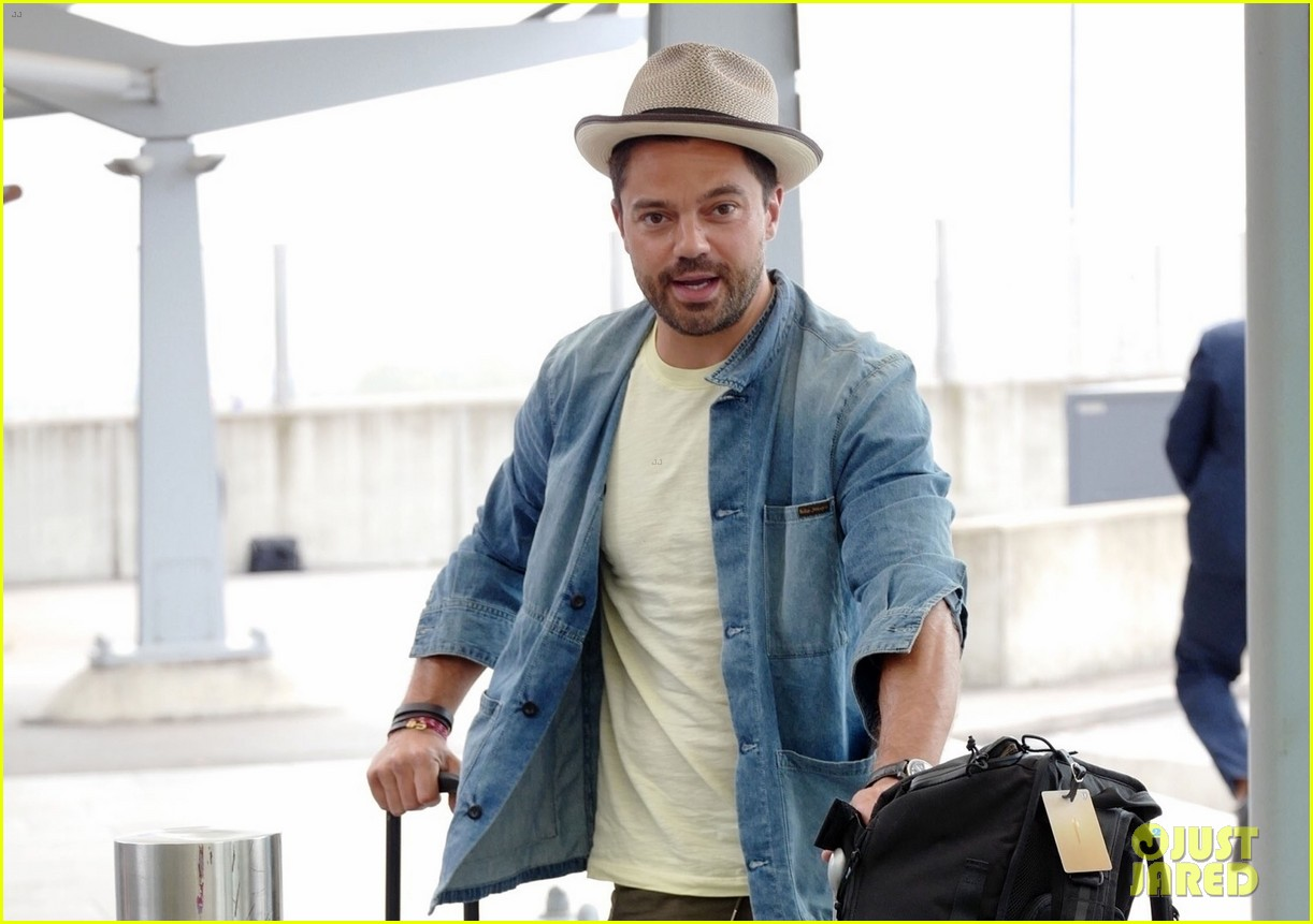 dominic cooper catches flight with lots of luggage 054323121