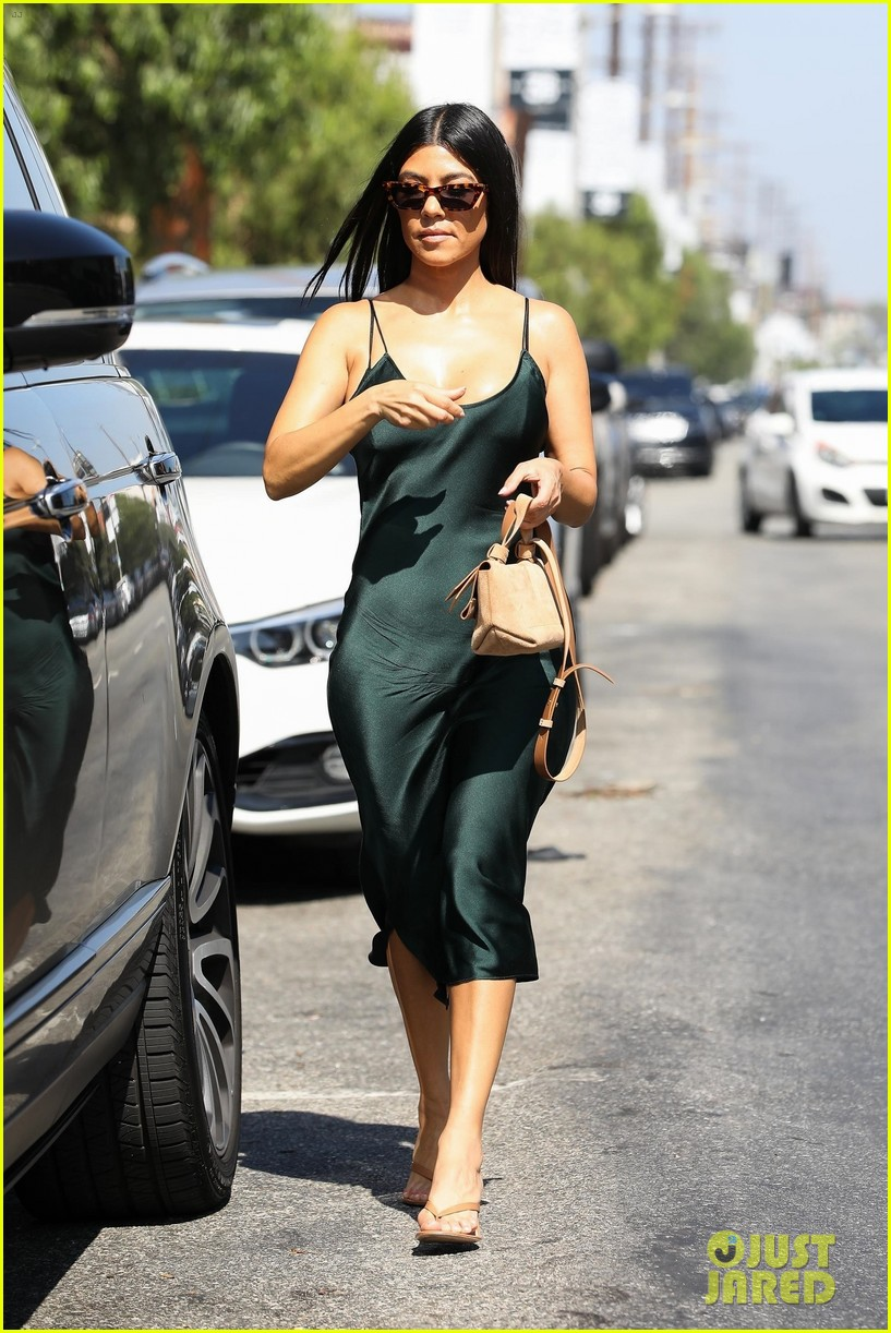 kourtney kardashian dons black silk dress for shopping trip 05