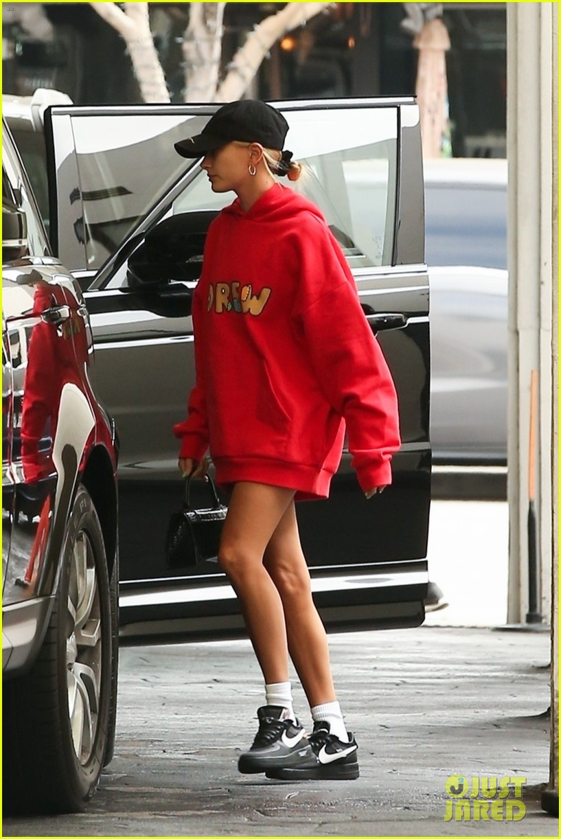 justin and hailey bieber pop in red outfits while running errands 034338987