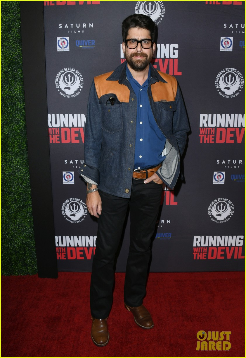 nicolas cage gets support son weston at running with the devil premiere 034354093