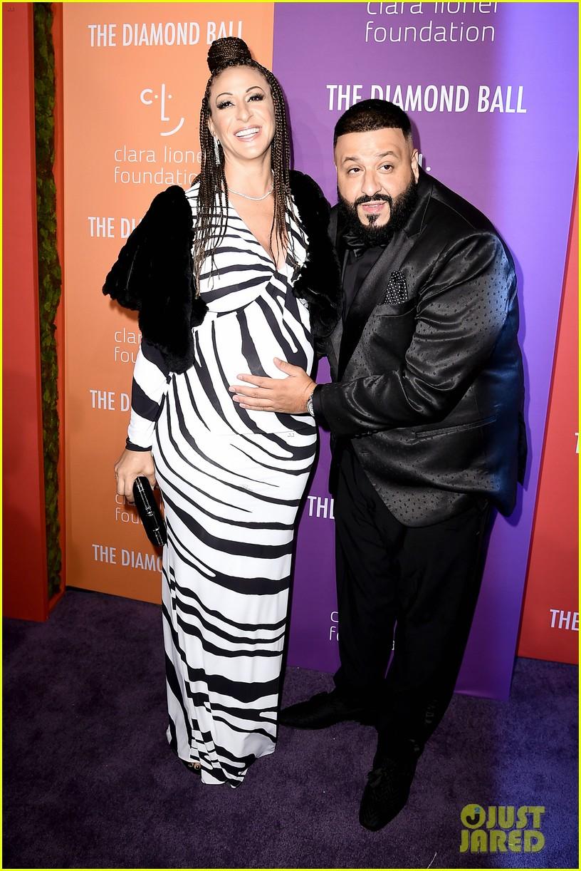 dj khaled cradles pregnant nicole tuck baby bump diamond ball 024352024