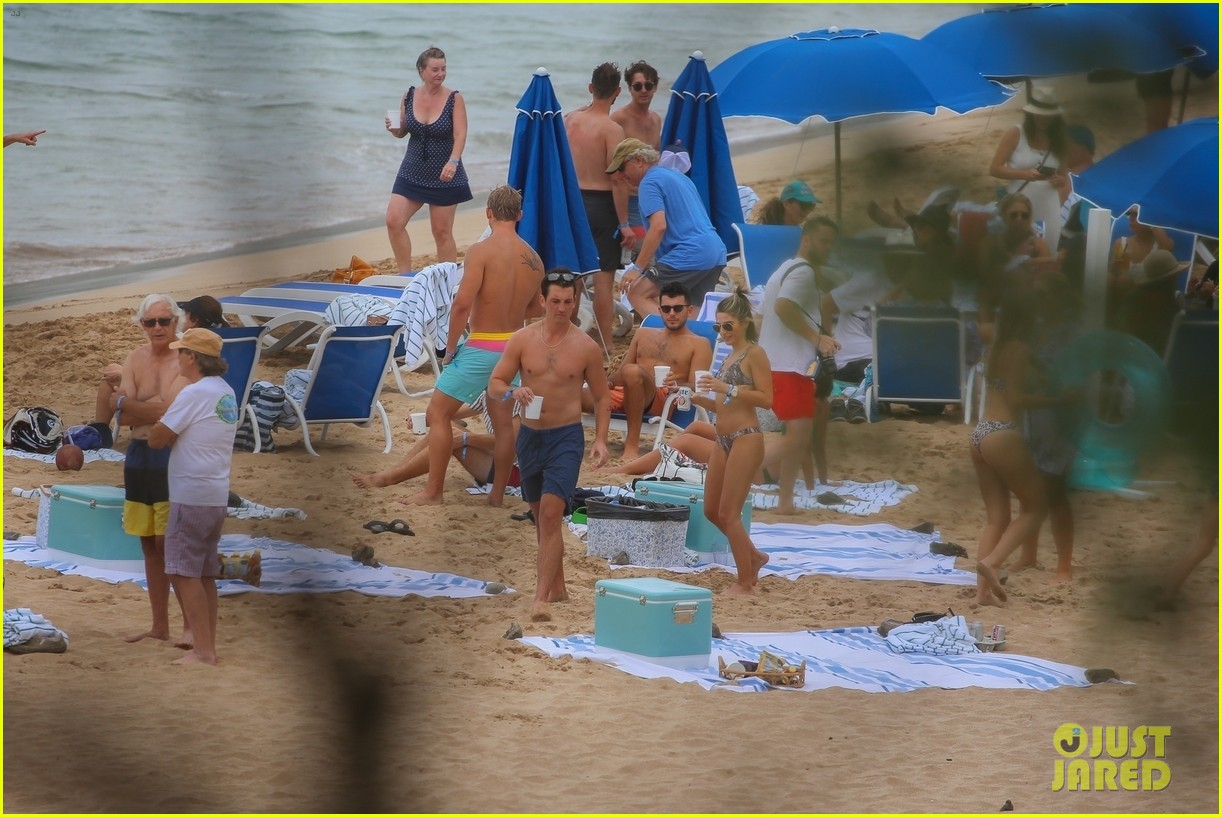 miles teller nina dobrev at the beach hawaii 204344076
