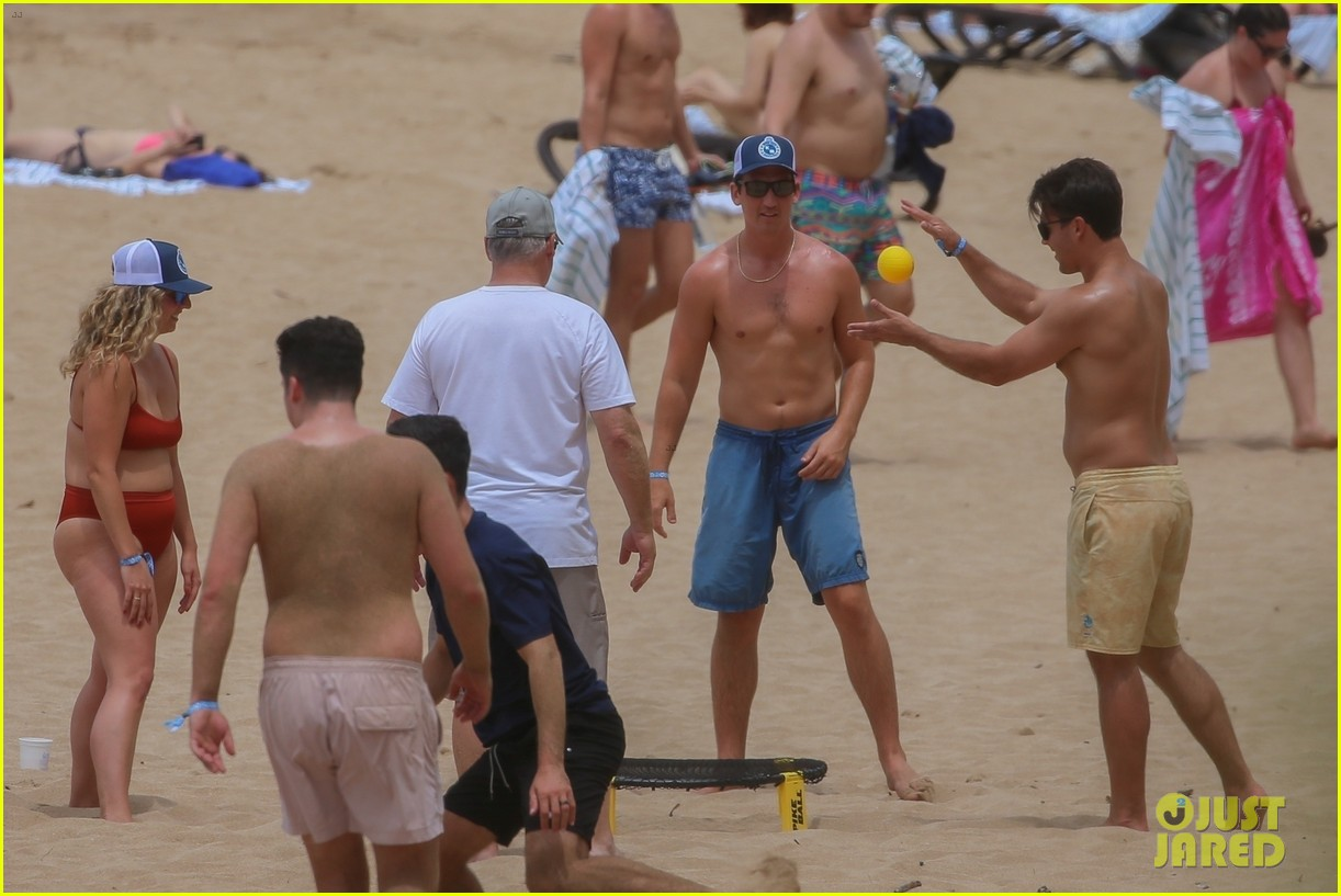 miles teller nina dobrev at the beach hawaii 224344078