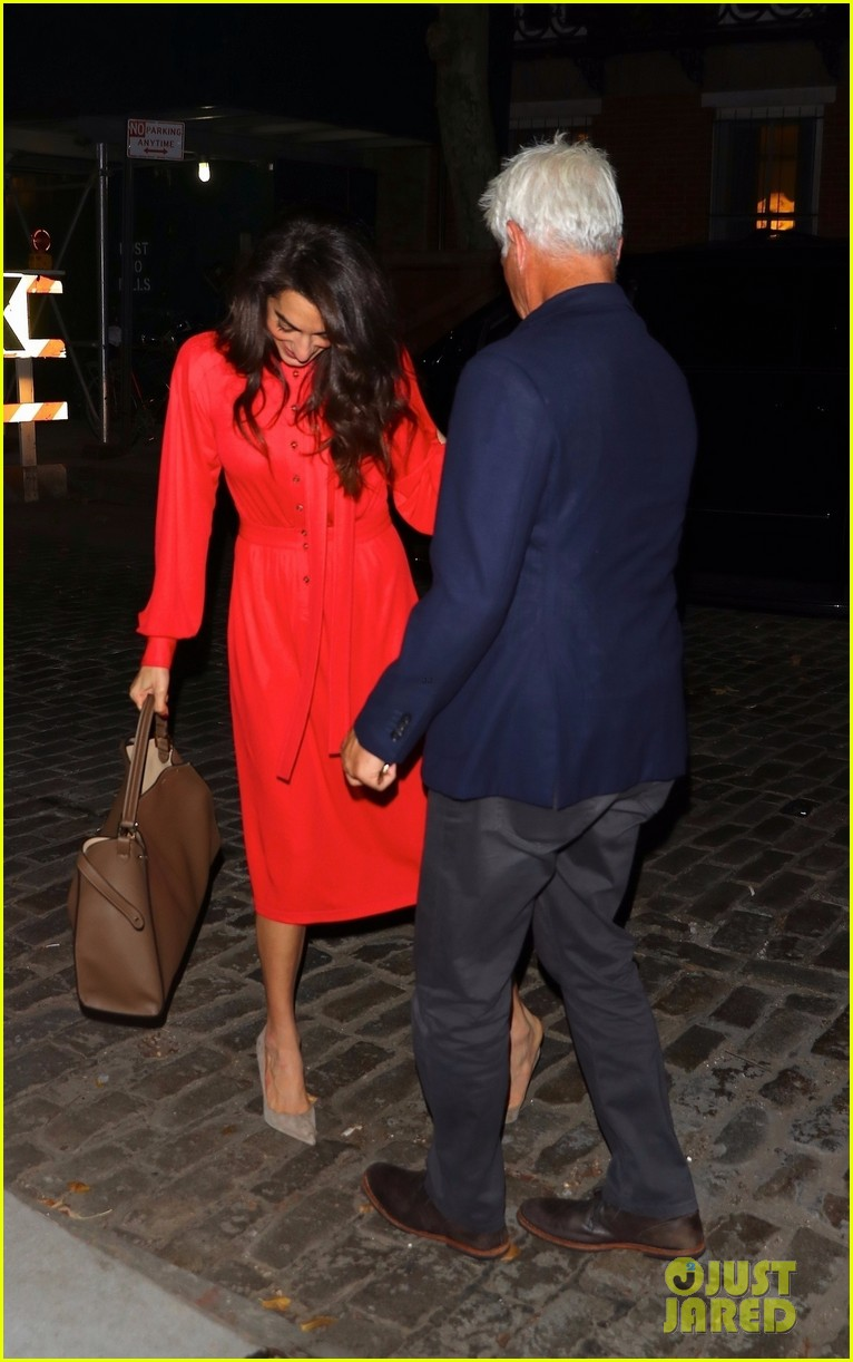 amal clooney nearly takes a tumble in heels recovers with a smile 044379466