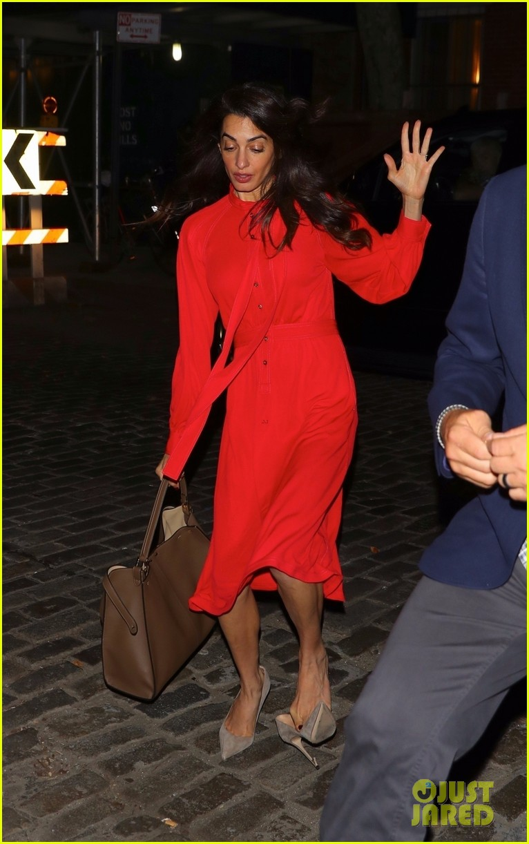 amal clooney nearly takes a tumble in heels recovers with a smile 054379467