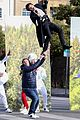 harry styles zip lines over la street for late late show segment 09