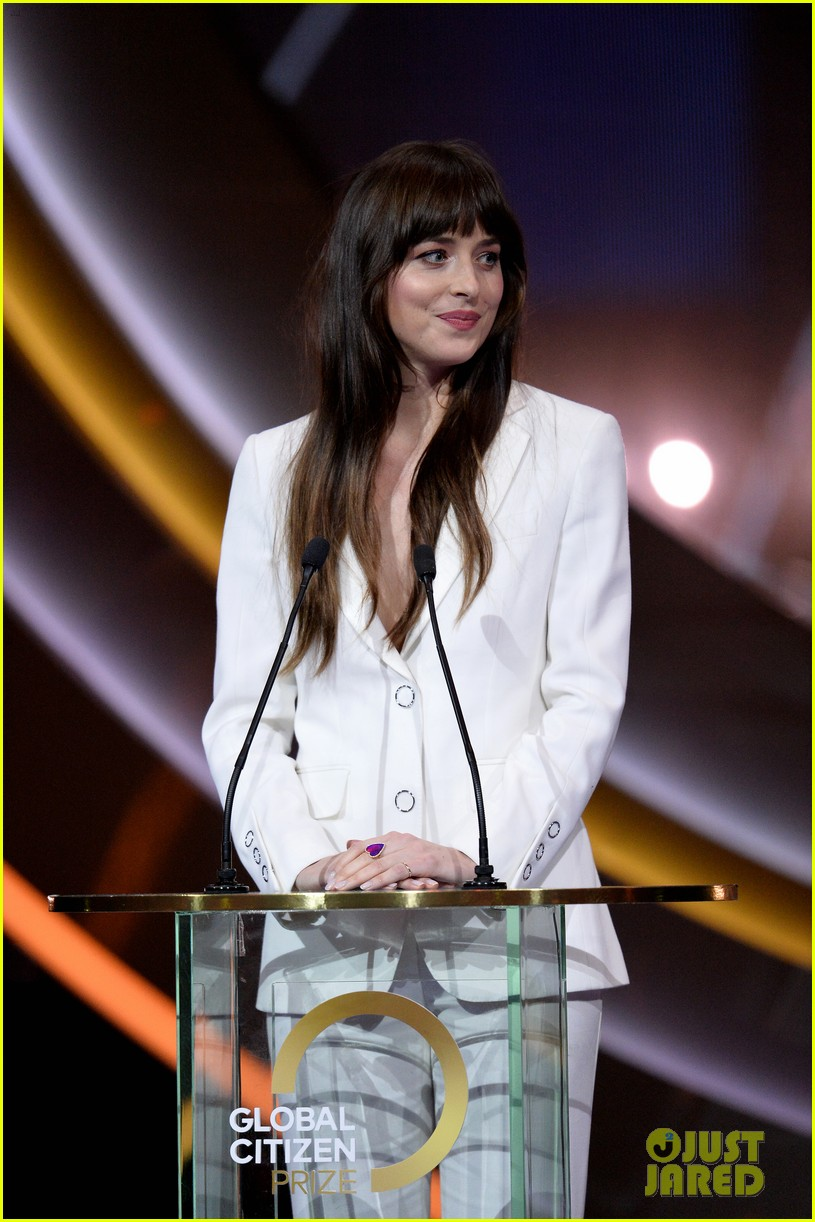Dakota Johnson & Chris Martin Make Appearances at Global ...