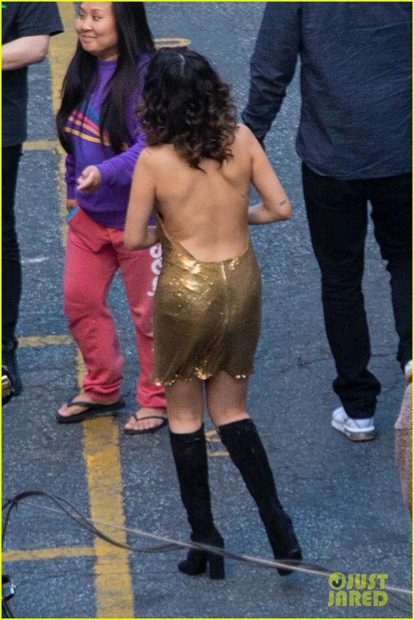 Selena Gomez Rocks Backless Gold Dress For Video Shoot In