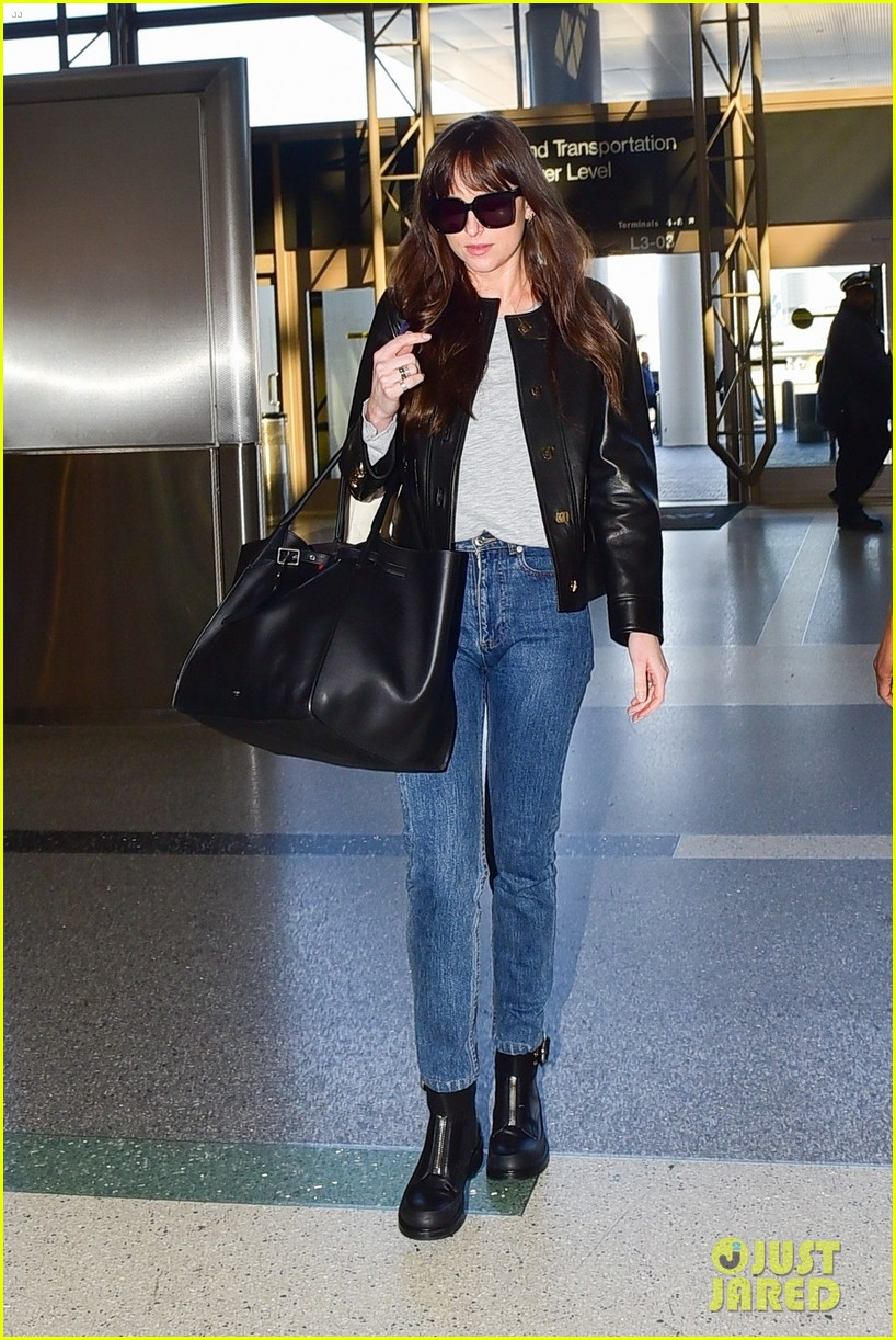 dakota johnson catches a flight out of town valentines day 044437792