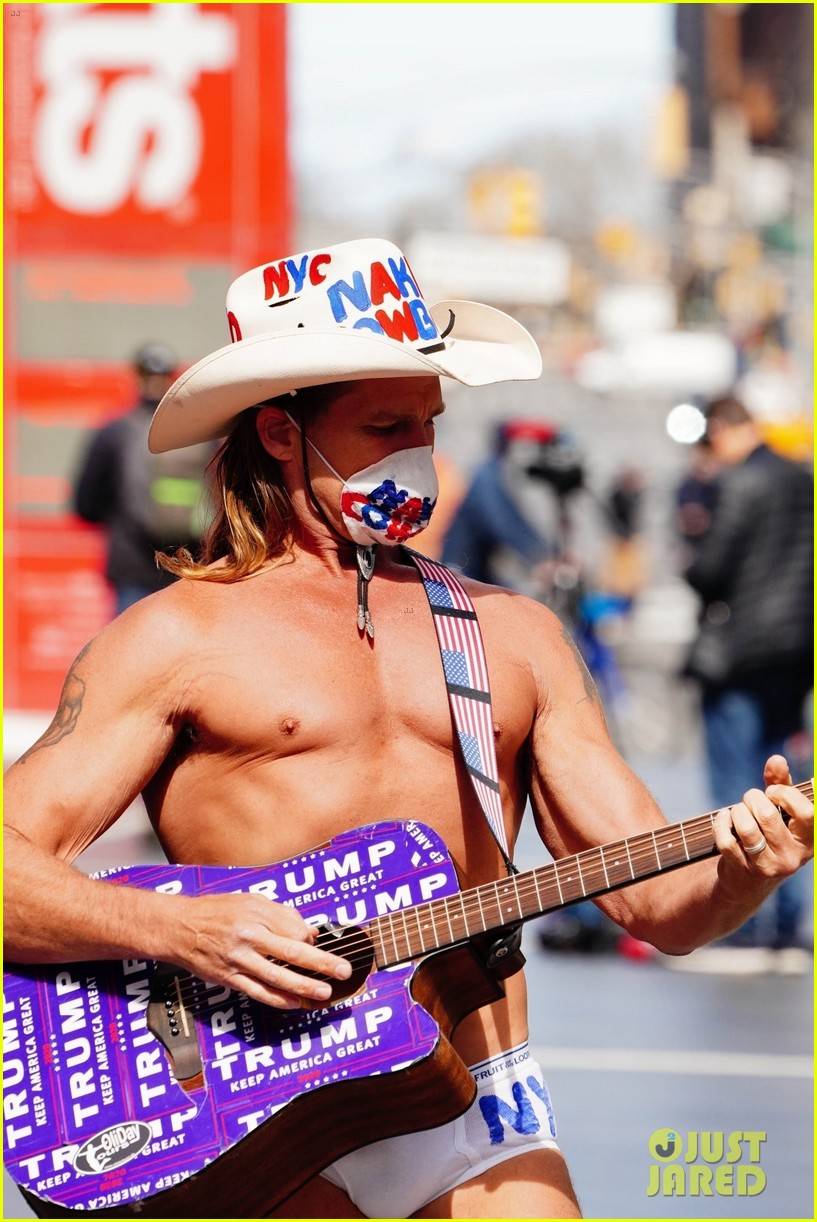 naked cowboy busking in a face mask 034451084