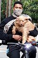 usher carries his dog bike ride girlfriend jennifer giocoechea 07