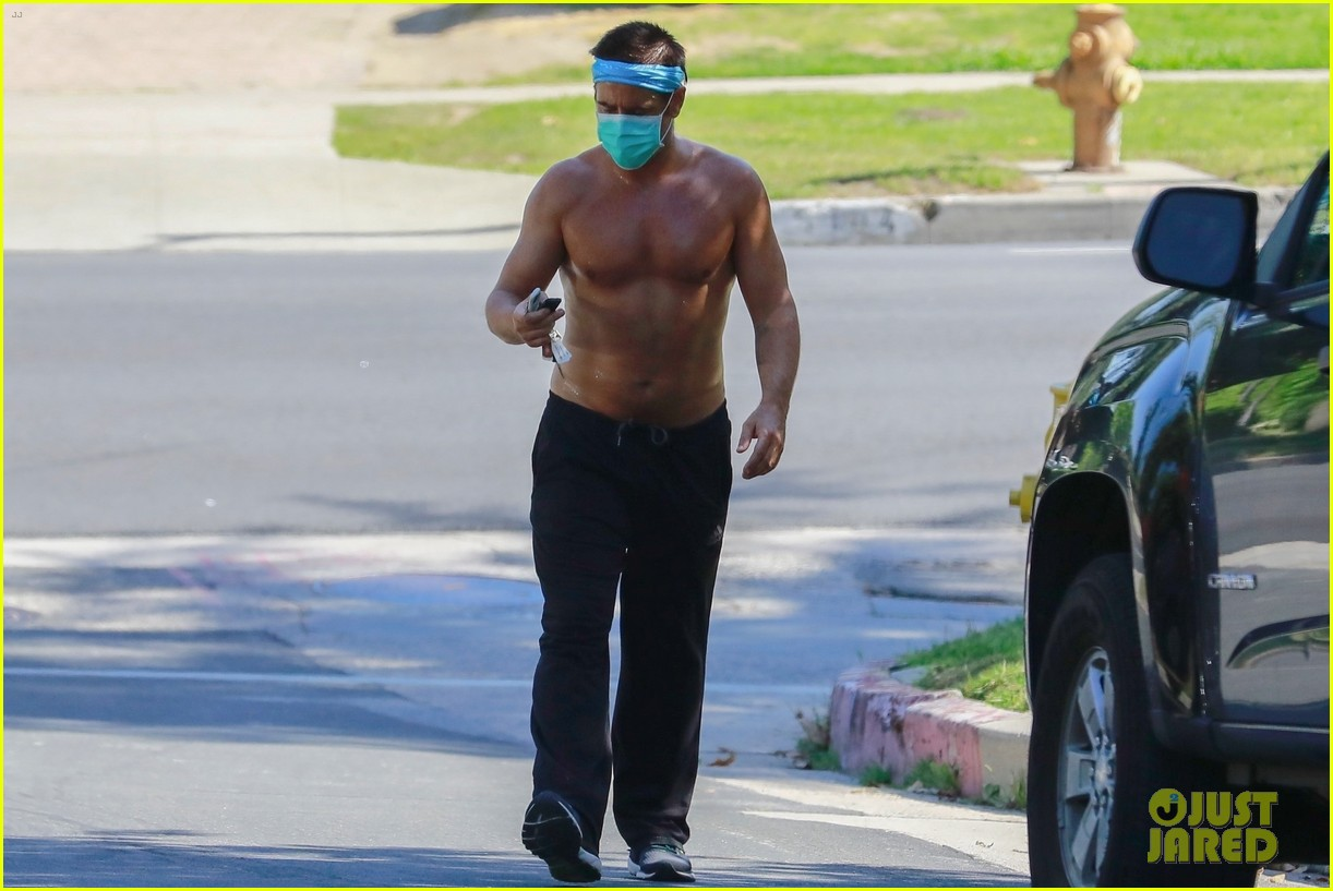 colin farrell shirtless for masked stroll 124457809