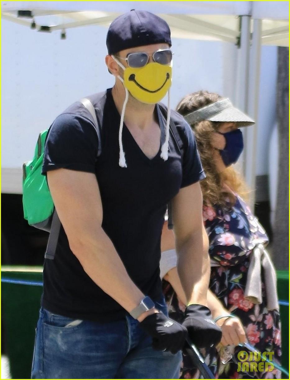 joel mchale wears smiley face mask farmers market 014457648