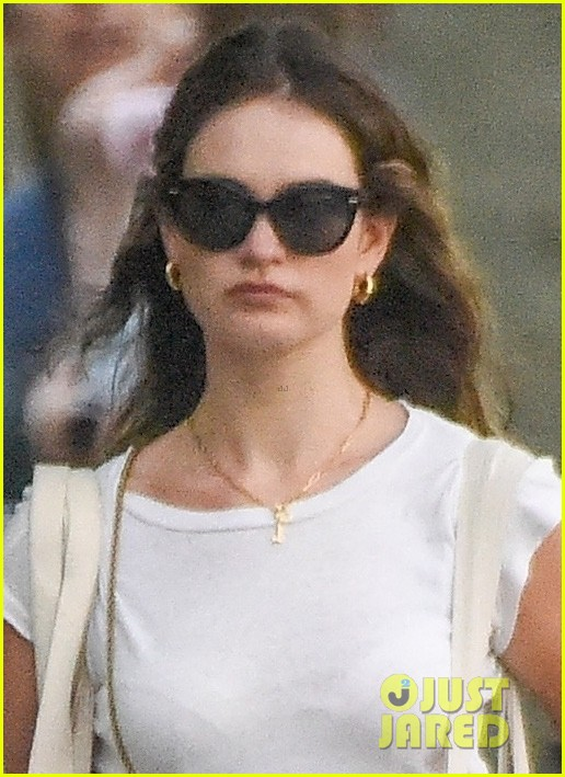 lily james picks up tulips out shopping london 024461293