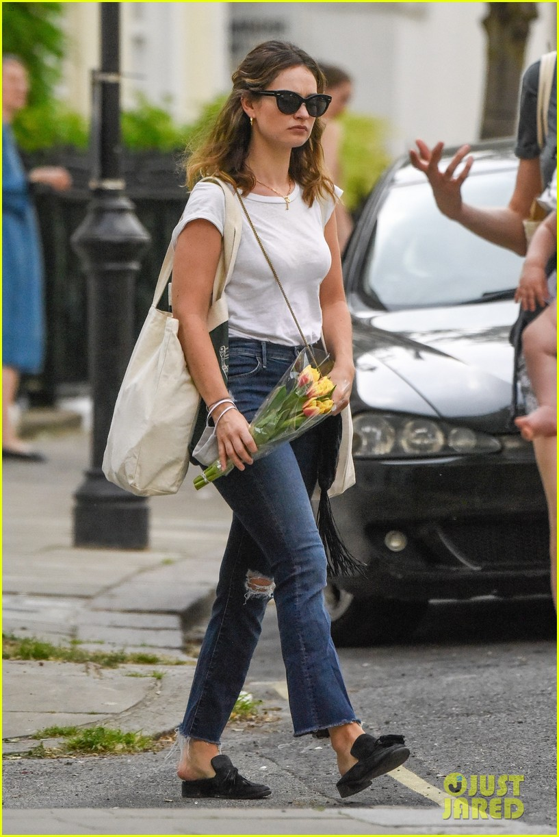 lily james picks up tulips out shopping london 034461294