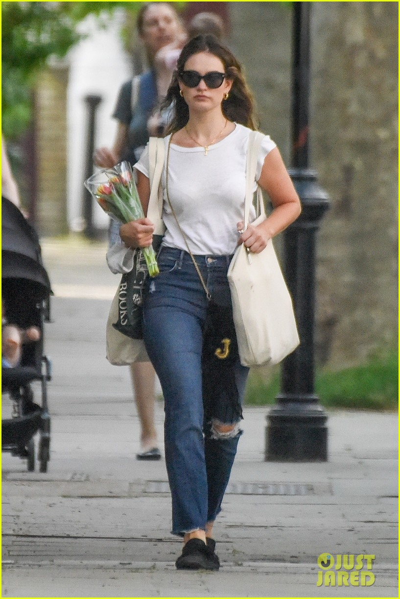 lily james picks up tulips out shopping london 054461296