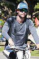 patrick schwarzenegger throws up peace on a bike ride 04
