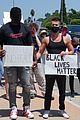 Photo 2 of NFL Player Ryan Russell Protests for Black Lives Matter with Boyfriend Corey O'Brien