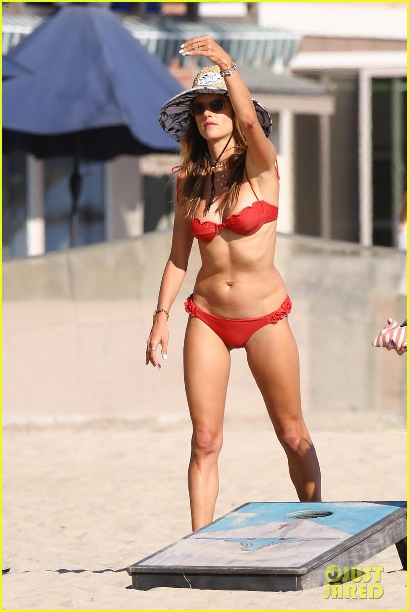 alessandra ambrosio plays cornhole with friends on the beach 054473046