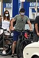 gerard butler kisses girlfriend morgan brown through his mask 05