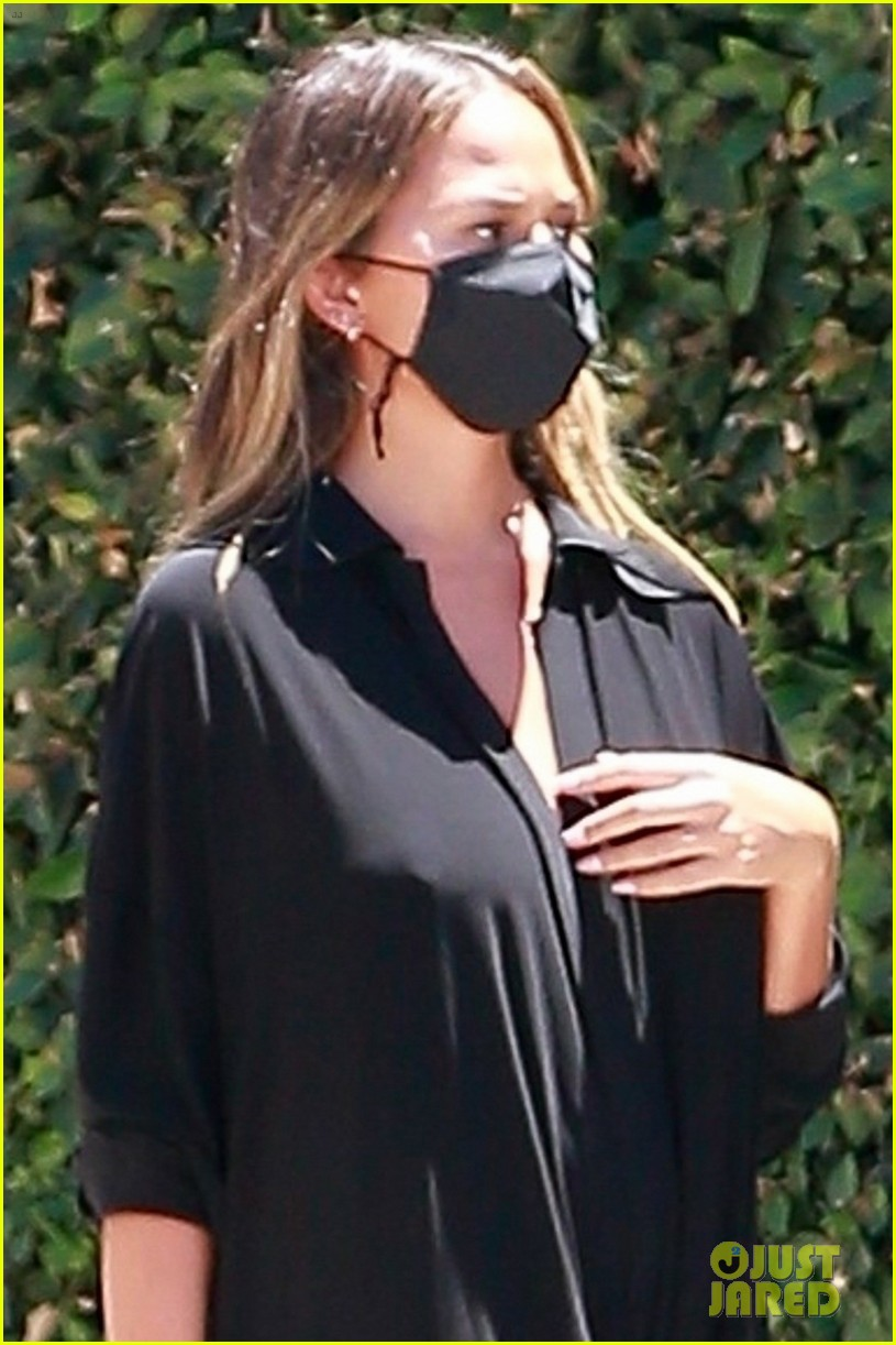 chrissy teigen rocks black jumpsuit while running errands 024473038