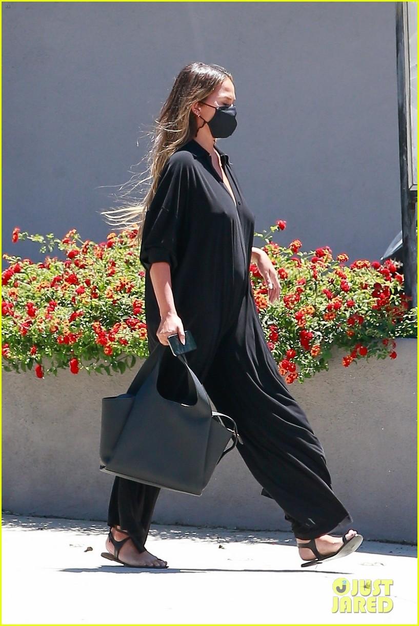 chrissy teigen rocks black jumpsuit while running errands 034473039