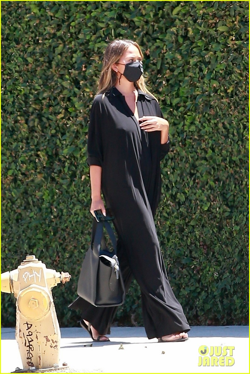 chrissy teigen rocks black jumpsuit while running errands 054473041