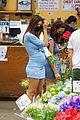 emily ratajkowski cradles her growing baby bump shopping for flowers 09
