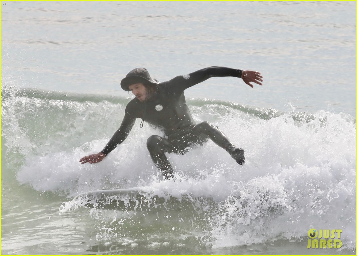 leighton meester adam brody surfing at the beach 044516996