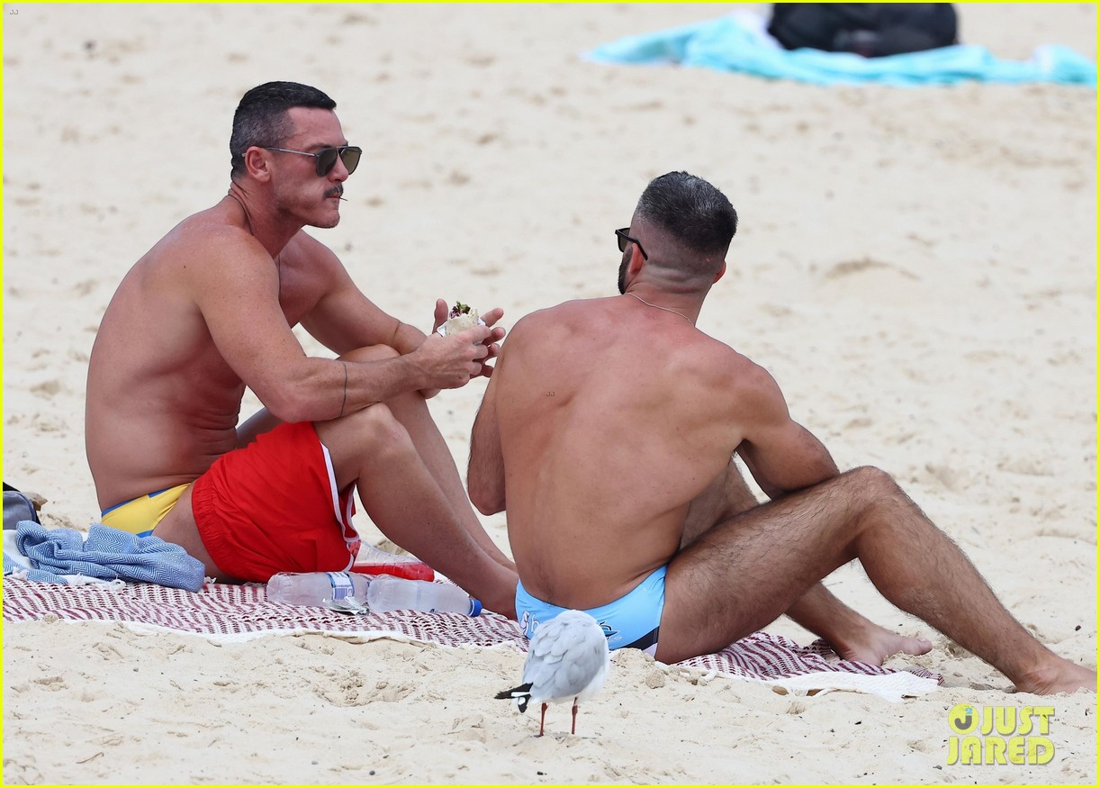 Full Sized Photo of luke evans tiny red shorts trip to the