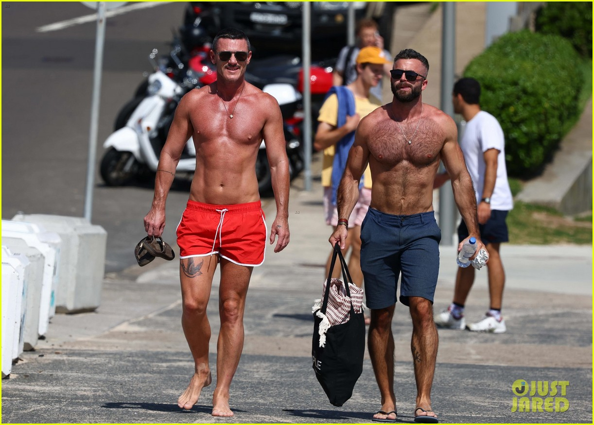Luke Evans Shows Off New Leg Tattoo in Tiny Bathing Suit