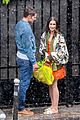 lily collins caught in rain with lucas bravo emily in paris 12
