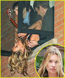 Kate Moss Hangs Out of Window