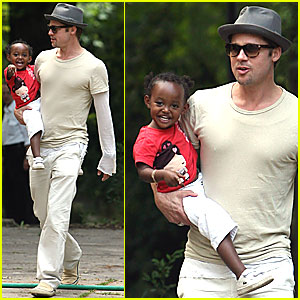 Brad Pitt Carries Super Smiley Zahara