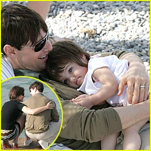 Tom Cruise Cradles Baby Suri