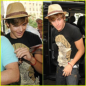 Zac Efron Gets Funky in a Fedora