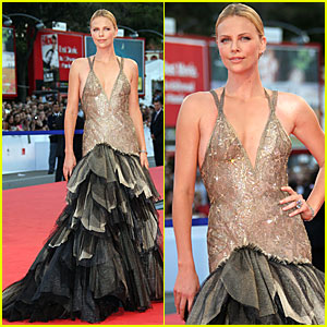 Charlize Theron is a Feather Duster