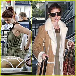 Debra Messing Gets Checked Out