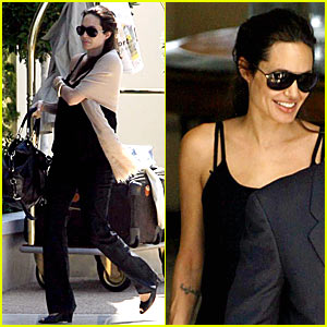 Mom-to-be Angelina Jolie is all smiles at the Grand Hotel Du Cap-Ferrat in ...