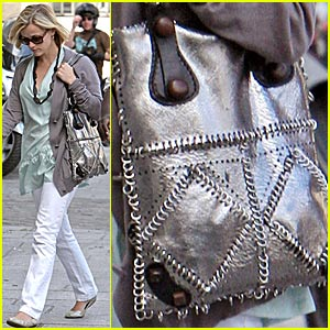 Reese Witherspoon's Purse Gets Pierced