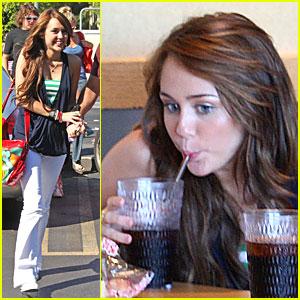 Miley Cyrus Gets Straw Silly