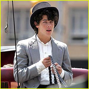 Nick Jonas Horses Around in a Top Hat