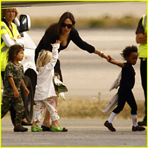 Brad and Angelina Jet Off With Twins