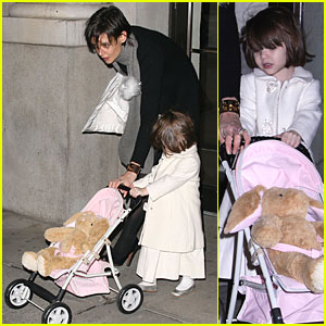 Suri Cruises With Her Stroller