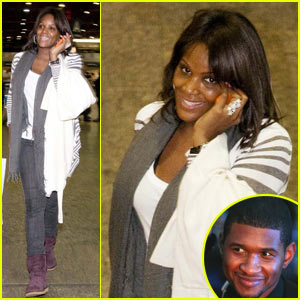 Usher's Wife is Still Smiling