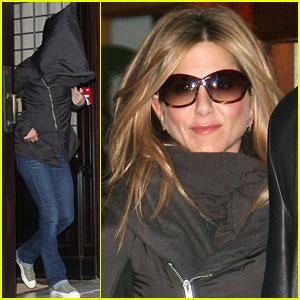 Jennifer Aniston Hides Under Her Hoodie