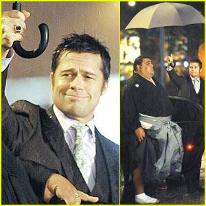 Brad Pitt is an Umbrella Holder